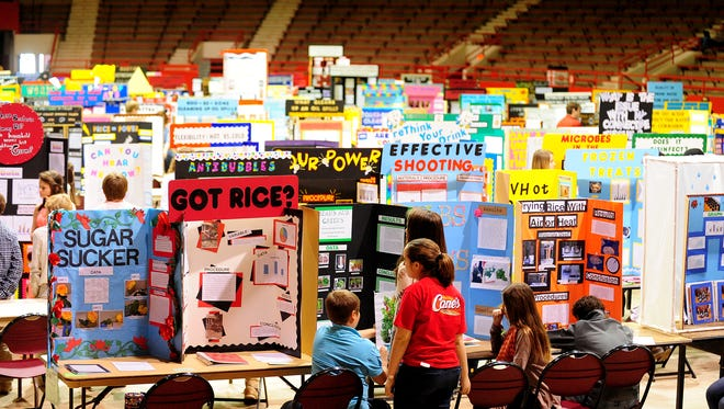 The Louisiana Region IV Science and Engineering Fair takes place at Blackham Coliseum in Lafayette in 2014. Louisiana educators will soon begin reviewing the state's science education standards.
