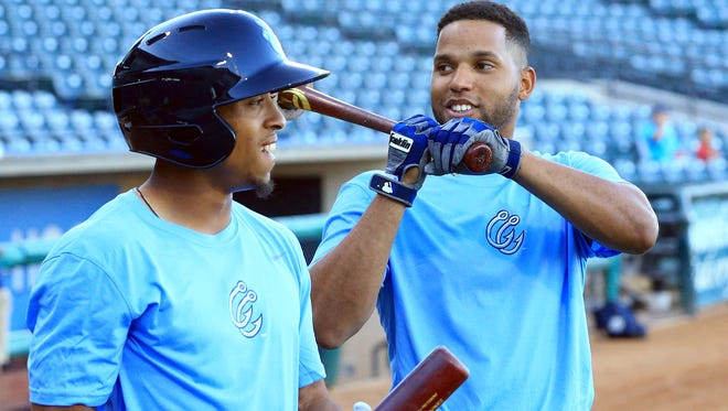 Hooks' Antonio Nunez (left) and Alejandro Garcia joke around as they prepare to bat during the 2017 Media Day on April, 3, 2017, at Whataburger Field in Corpus Christ.
