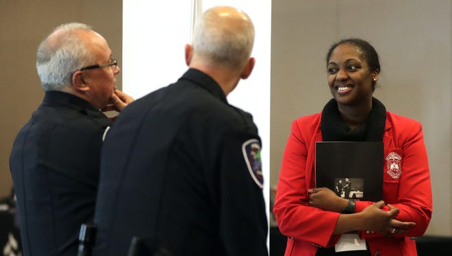 Jamila Seaton, a member of Delta Sigma Theta sorority, talks Friday with Appleton Police Department Capt. Rudy Nyman and Assistant Police Chief Larry Potter during the organization's career fair at the KI Convention Center in Green Bay. The career fair and other events focused on the benefits to employers of hiring a diverse workforce.
