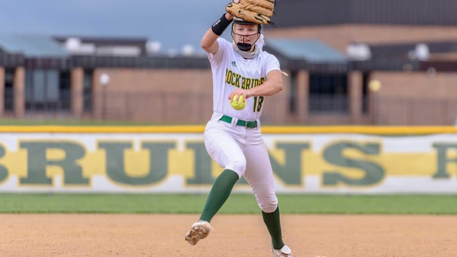 Rock Bridge senior Ella Schouten (18) pitches during a game against Battle on Tuesday night at Rock Bridge High School.