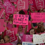 Planned Parenthood Action Council holds a community rally at the state Capitol Aug. 25 in Salt Lake City to protest Gov. Gary Herbert's decision to stop disbursing federal money to Planned Parenthood.