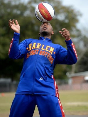 """Harlem Globetrotter Shane """"Scooter"""" Christensen performs for students at Oakcrest Elementary School on Tuesday while delivering the ABCs of Bullying Prevention. The program aims to give kids 6-12 the tools they can use to reduce bullying by supporting one another."""