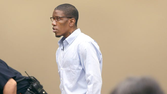 Thomas Johnson lll enters the courtroom for opening statements.