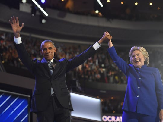 Jul 27, 2016; Philadelphia, PA, USA; President Barack Obama and Hillary Clinton stand on stage after Obama spoke during the 2016 Democratic National Convention at Wells Fargo Center.