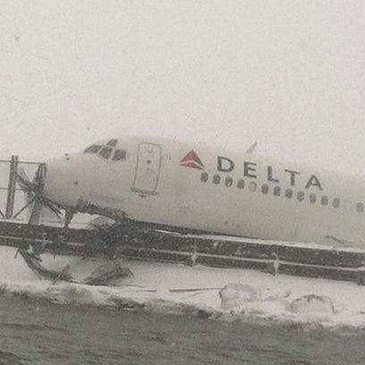 A plane landing at LaGuardia skidded off the runway