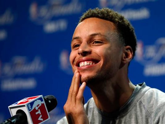 Golden State Warriors guard Stephen Curry answers a question during press conference for basketball's NBA Finals in Cleveland, Wednesday, June 10, 2015. The Cleveland Cavaliers lead the Warriors 2-1 in the best-of-seven games series.  Game 4 is scheduled for Thursday. (AP Photo/Paul Sancya)