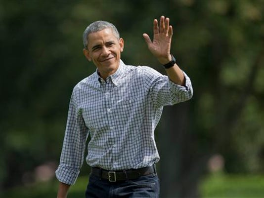 President Barack Obama waves as he walks on the South Lawn upon arrival at the White House in Washington, Sunday, Aug. 2, 2015, from Camp David, Md.
