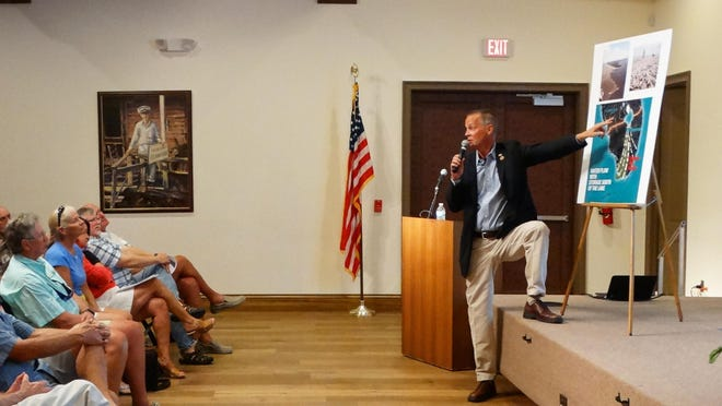 U.S. Rep. Curt Clawson tells a Marco audience Monday night he is concerned about the effects of Lake Okechobee brown-water discharges.