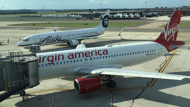 Alaska Airlines and Virgin America aircraft are seen at Washington Dulles International Airport on Aug. 12, 2016.