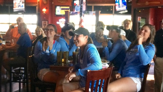 MTSU women's golf team react to being selected in the Shoal Creek NCAA regional on Monday at Sam's Sports Grill.