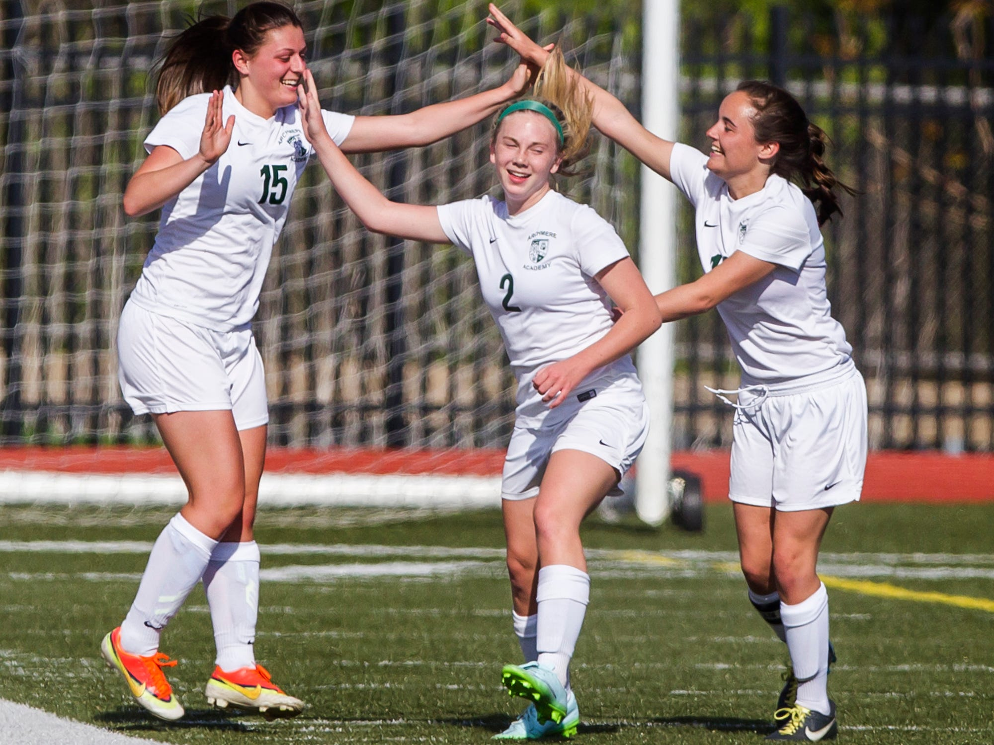 Archmere's Madeline Law (left), Madison Love (right) and Madelyn Heck (center) celebrate after a corner kick by Law deflected off a St. Mark's player and into the goal. Archmere defeated St. Mark's by a score of 2-1.