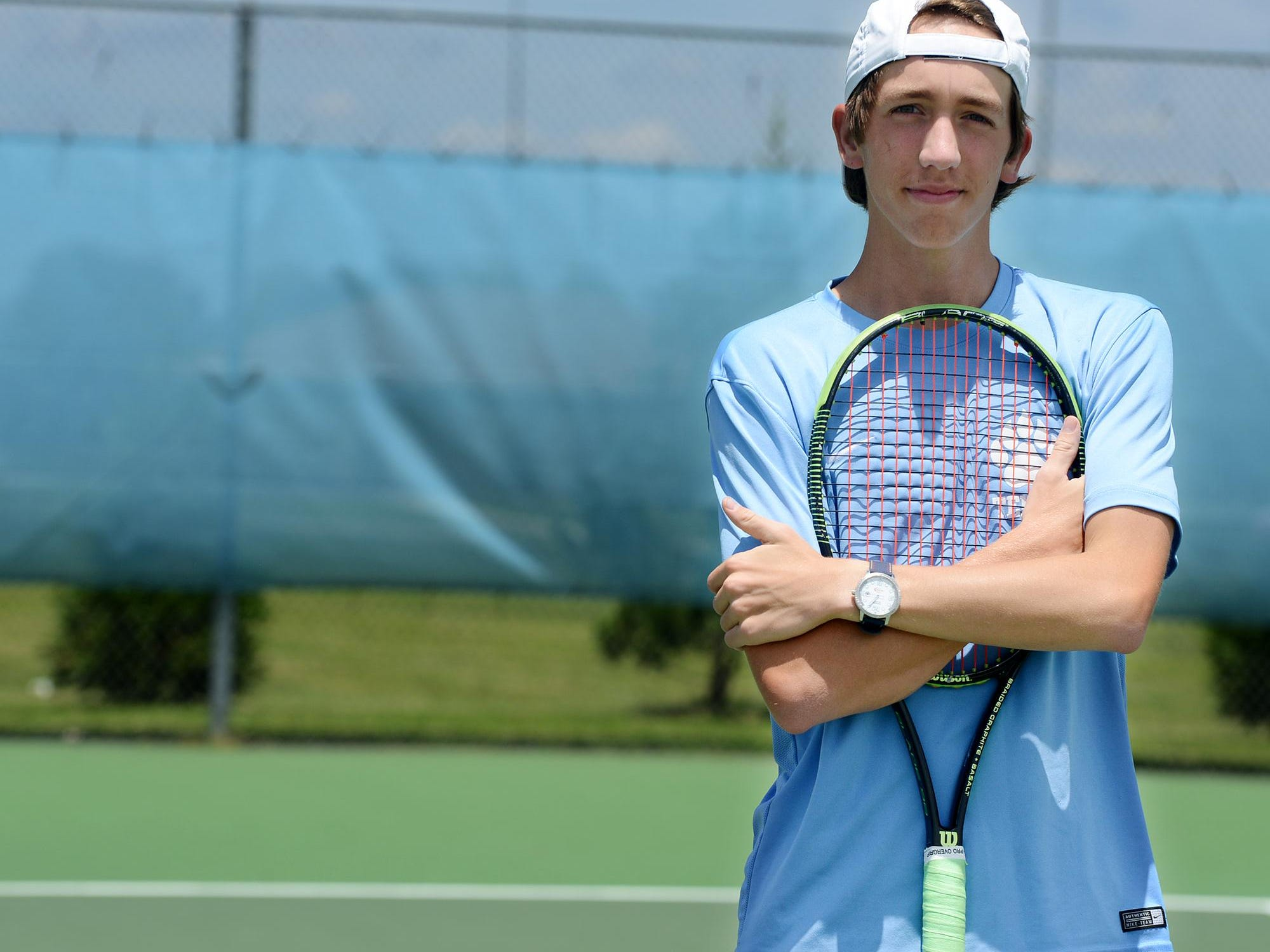 University School of Jackson's Cade Reasons won doubles gold along with George Markos at the Division II-A state tournament.