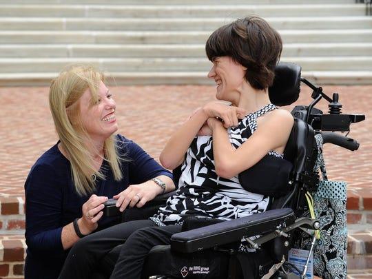 Senate Majority Whip Nicole Poore, D-New Castle, speaks with Brigitte Hancharick, right, at Legislative Hall in Dover.