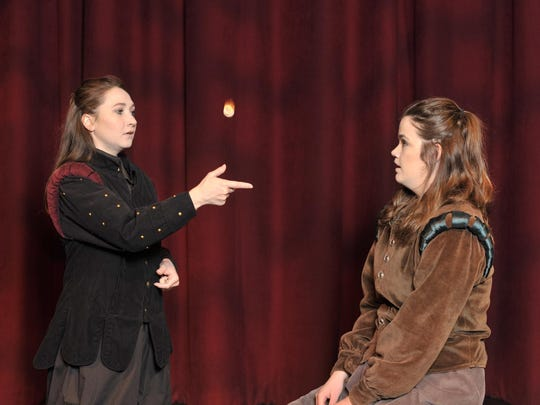 "Schyler Mayo flips a coin to Kami Hinds in the College of Sequoias production of ""Rosencrantz & Guildenstern are Dead."""