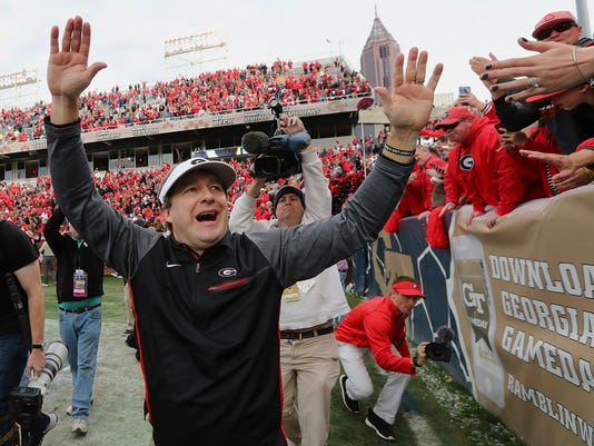 Georgia head coach Kirby Smart celebrates with fans after beating Georgia Tech 38-7 in an NCAA college football game on Saturday, Nov. 25, 2017, in Atlanta. (Curtis Compton/Atlanta Journal-Constitution via AP)