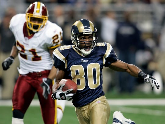 FILE - In this Dec. 24, 2006, file photo, St. Louis Rams' Isaac Bruce (80) eludes Washington Redskins Sean Taylor after making a catch during the first half of an NFL football game in St. Louis.  Randy Moss, Terrell Owens and Bruce, among others, are on the ballot in voting Saturday, Feb. 3, for the Pro Football Hall of Fame. (AP Photo/Tom Gannam, File)