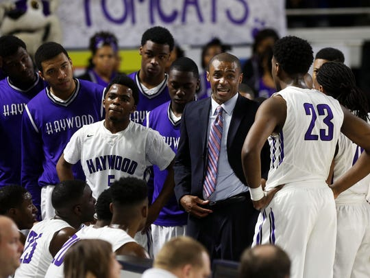 Haywood coach Kendall Dancy talks to his team during a timeout against Carter in the second half Thursday in the Class AA state quarterfinals at MTSU.