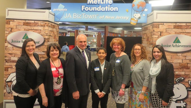 Junior Achievement of New Jersey recently held one of its JA Biztown economic simulation with St. Thomas the Apostle School in Old Bridge. Pictured from left to right are Stephanie Karpowicz, director of JA Capstone Programs; Theresa Pasqua, a St. Thomas teacher; Old Bridge Mayor Owen Henry; Pierre Ishak, JA BizTown student mayor, and teachers Mary Conaghan, Catherine Draeger, and Lani Brown.