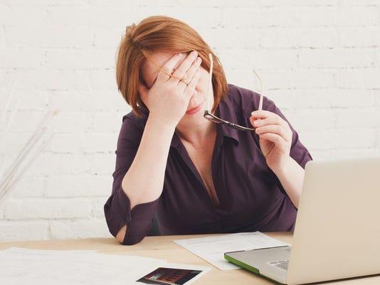 Depressed businesswoman in her office