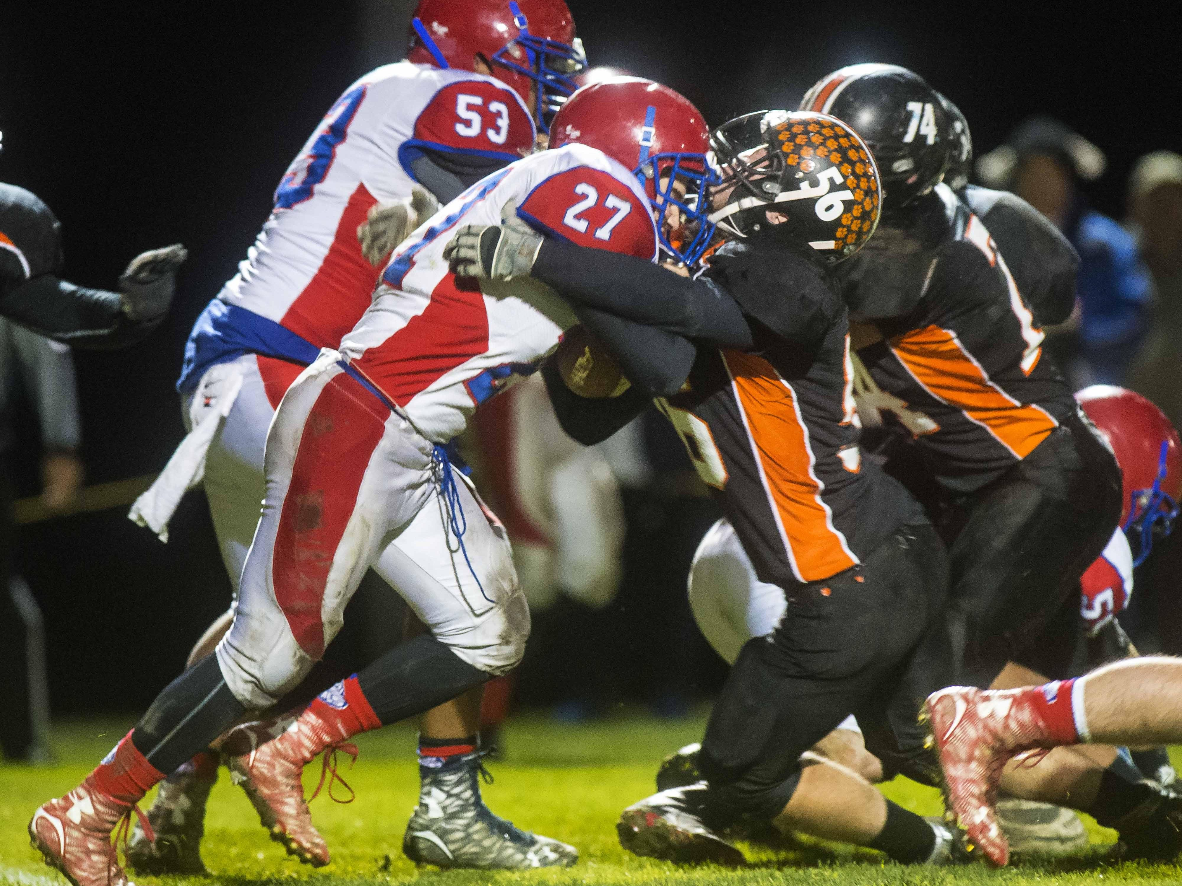 Middlebury's Bruce Wright, right, stops Hartford's Walkker Judd in Middlebury on Friday, October 30, 2015.