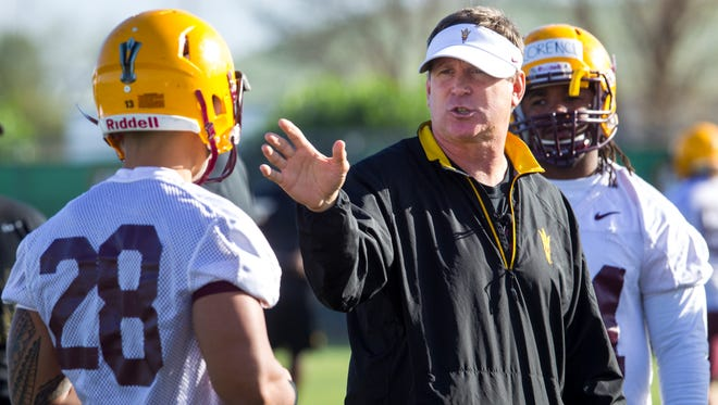 Arizona State defensive coordinator Keith Patterson gives instruction to players at the first day of ASU's spring football practice in Tempe on Tuesday, March 18, 2014.