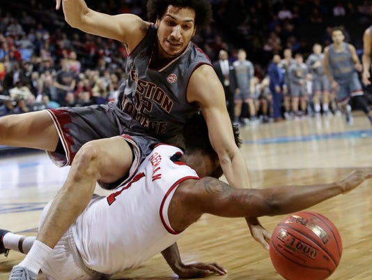 Boston College's Johncarlos Reyes, top, fights for control of the ball with North Carolina State's Lennard Freeman (1) during the first half of an NCAA college basketball game in the second round of the Atlantic Coast Conference tournament Wednesday, March 7, 2018, in New York. (AP Photo/Frank Franklin II)