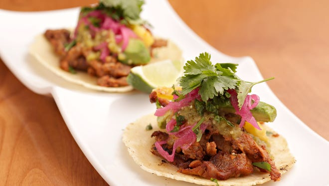 The pork al pastor taco is dressed up with avocado, pickled onions and pineapple salsa from SumoMaya in Scottsdale.