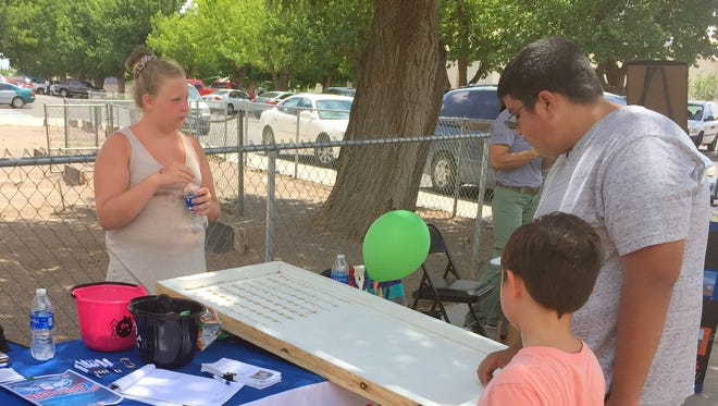 The Court Appointed Special Advocates (CASA) table kept children entertained with games and prizes while handing out literature seeking volunteers for its program which supports foster children in the area filter through the New Mexico court system.