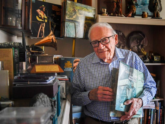 Photographer Les Leverett poses with the Porter Wagoner album for which he won a Grammy at his home in Goodlettsville on Tuesday, April 10, 2018.