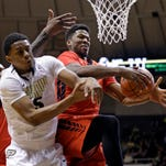 Rutgers center Kadeem Jack, right, grabs a rebound next to Purdue forward Basil Smotherman, left, in the first half of an NCAA college basketball game in West Lafayette, Ind., Thursday, Feb. 26, 2015. (AP Photo/Michael Conroy)