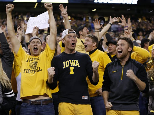 Iowa fans cheer after quarterback C.J. Beathard threw