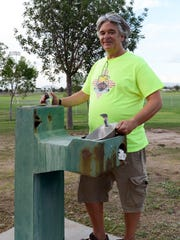 Steve Hanson, vice president of the Las Cruces Youth Soccer League, stands near one of two water fountains at the High Noon soccer complex, both of which are broken