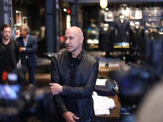 Menswear designer John Varvatos speaks to the press
