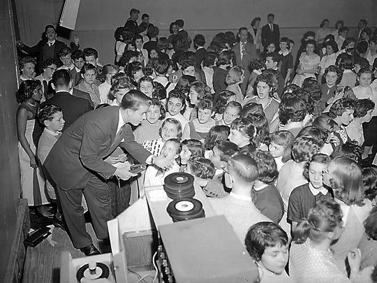 """American Bandstand's"" Dick Clark hosts a record hop"