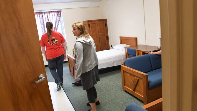 Members of the community tour the new independent living apartments at the Virginia School for the Deaf and the Blind.
