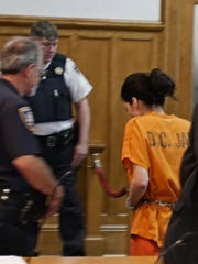 Nicole Addimando is led out of her arraignment in Dutchess