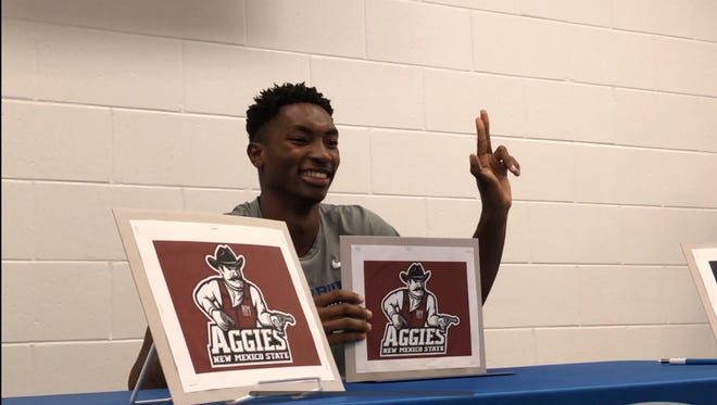 Canterbury's Berrick Jeanlouis signed to play basketball at New Mexico State in a ceremony Monday at the school.
