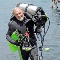 Lloyd Cunningham spends more time scuba diving at Lake Okobogi after his retirement.