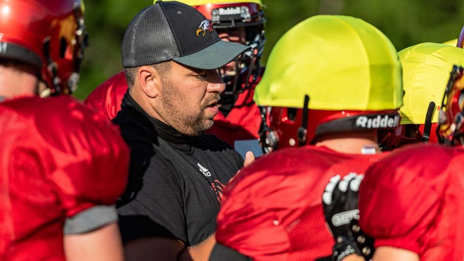 Southern Boone head football coach Trent Tracy works with his players during preseason practice Thursday at Southern Boone High School.