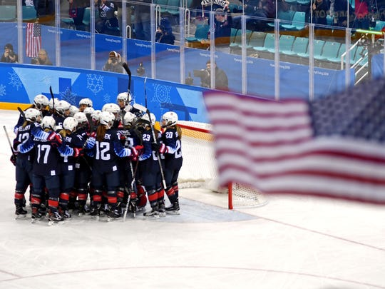 The United States celebrates beating Finland in the women's ice hockey semifinals during the Pyeongchang 2018 Olympic Winter Games at Gangneung Hockey Centre.