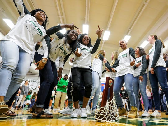 (left to right) Destanni Henderson, Autumn Giles , Bethany Brunson, and  Jarya Outten, dance around the trophy after cutting down the net during a pep rally to celebrate their 2017 State Championship win. Fort Myers High School held a pep rally to celebrate their 2017 State Championship win.