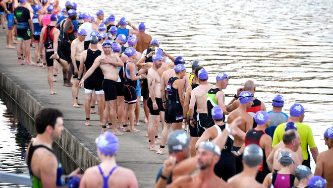 Participants wait to enter the Cumberland River during the 39th annual Music City Triathlon last year.