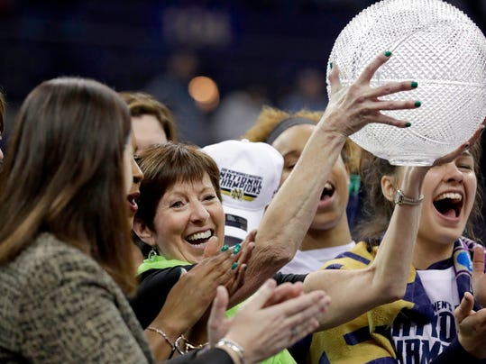 Notre Dame head coach Muffet McGraw celebrates after defeating Mississippi State in the final of the women's NCAA Final Four college basketball tournament, Sunday, April 1, 2018, in Columbus, Ohio. Notre Dame won 61-58. Notre Dame won 61-58. (AP Photo/Tony Dejak)