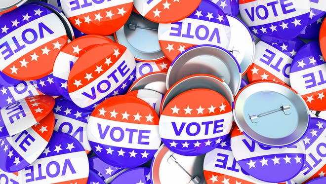 Buttons urging citizens to vote. Lansing's City Council race is Nov. 3.