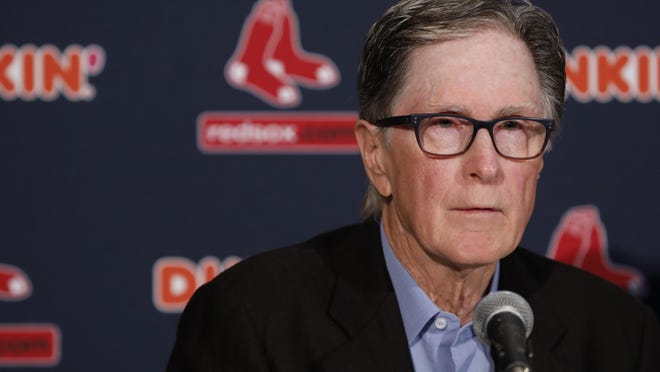 Boston Red Sox owner John Henry talks with the media at Fenway Park on Jan. 15, 2020.