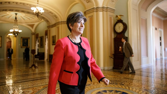 Sen.-elect Joni Ernst, R-Iowa strides through the halls of the Senate on Capitol Hill in Washington, Wednesday, Nov. 12, 2014, as lawmakers return for the lame duck session following the midterm elections and new members begin their orientation.