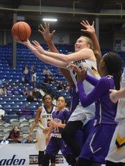 Benton High School's Emily Ward (21, left) goes up