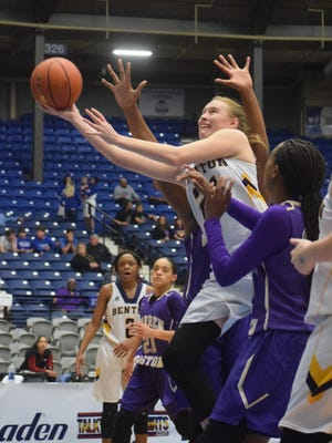 Benton High School's Emily Ward (21, left) goes up for two against Warren Easton in the LHSAA Class 4A semifinals held Tuesday, Feb. 27, 2018 at the Rapides Parish Coliseum in Alexandria.