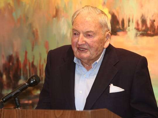 David Rockefeller greets the crowd at the Rockefeller