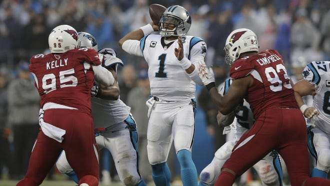 Carolina Panthers quarterback Cam Newton (1) passes against the Arizona Cardinals in the first half of an NFL wild-card playoff football game in Charlotte, N.C., on Saturday, Jan. 3, 2015.